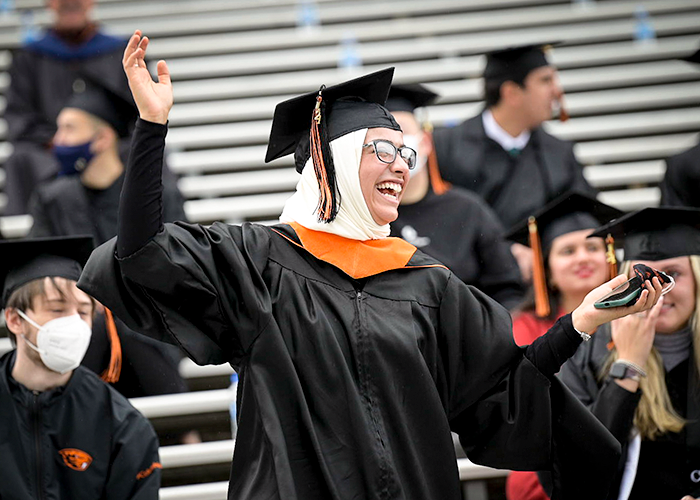 OSU 2021 grad cheering in Reser stands to celebrate graduating