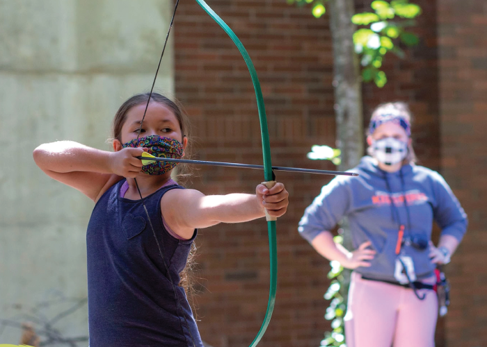 Photo of KidSpirit participant using a recurve bow